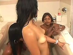 School black lesbian masturbates on sofa