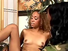 Teen black lesbian sucks dildo on terrace