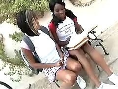 Ebony black lesbians caress each other